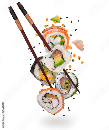 Fototapeta Pieces of delicious japanese sushi frozen in the air. Isolated on white background obraz