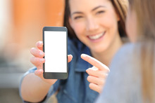 Woman Showing A Blank Smart Phone Screen To A Friend