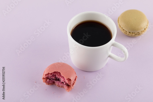 Fotobehang Macarons Macaron with bite mark and Coffee,Pastel colors, purple background