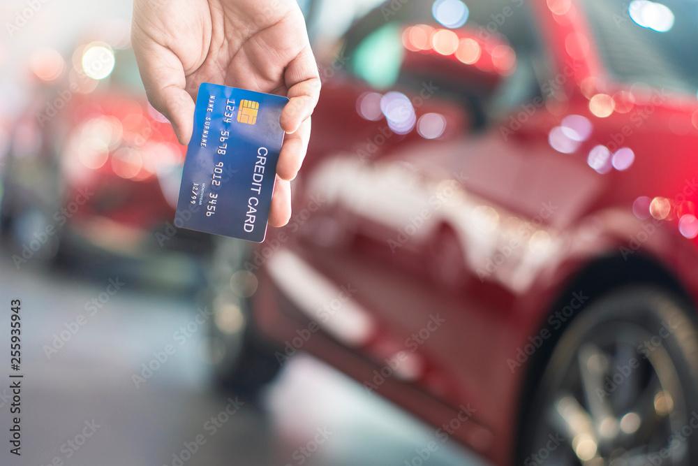 Fototapeta man holding credit card for blurred bokeh background e-shopping marketing digital, consumer purchase shopping internet online image