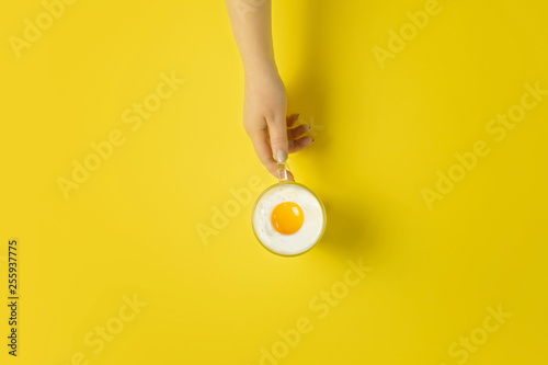 Egg in a cup, a creative concept of the beginning of Easter, sunny morning and g Wallpaper Mural