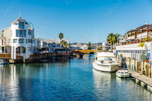 Knysna waterfront with houses and boats, part of Thesen island. Fototapeta