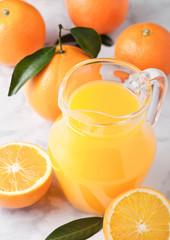 Glass jar of raw organic fresh orange juice