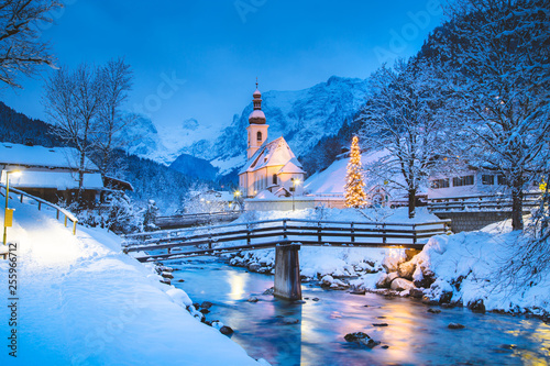 Tuinposter Blauwe jeans Church of Ramsau in winter twilight, Bavaria, Germany