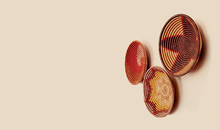Woven Decorative Baskets Hanging On A Wall; African Home Decor Items