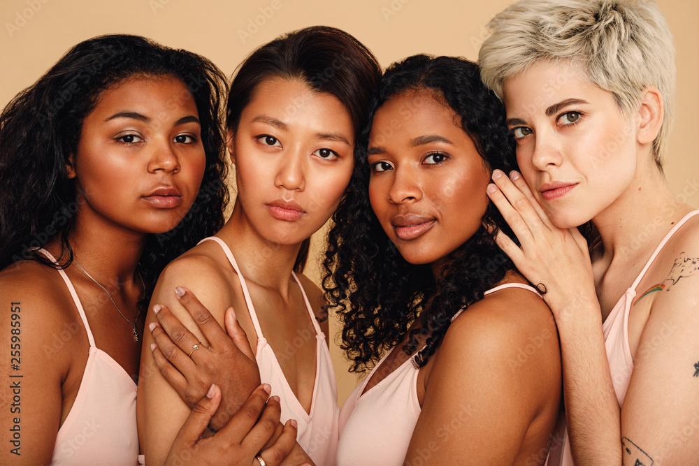 Fototapeta Studio portrait of a four women looking at camera