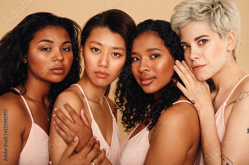 Obraz Studio portrait of a four women looking at camera - fototapety do salonu