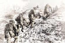 Group Of Special Forces Climbs Into The Mountains In Order To Take A Favorable Position To Protect The Target.