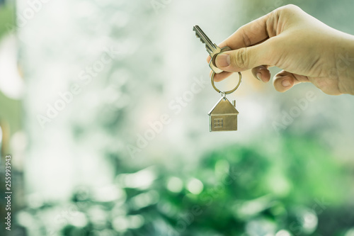 House model and key in home insurance broker agent 's hand or in salesman person Wallpaper Mural