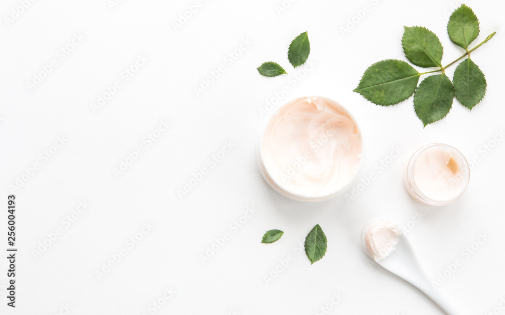Fototapety, obrazy: Composition with green leaves and hand cream. morning face and body care. spa and massage