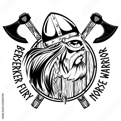 Photo Norse warrior Berserker. Viking head, shield and two crossed axes