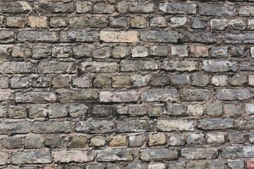 Stara Szara ściana z cegieł tła tekstura