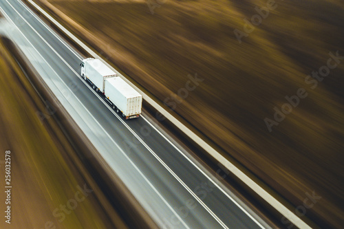 Foto White truck transport goods street road highway