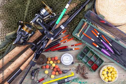 Fototapeta fishing tackle on a wooden table. toned image  obraz na płótnie