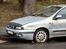 Light Blue Car Damaged In A Sl...