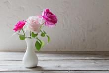 Pink Roses In Vase On White Ba...