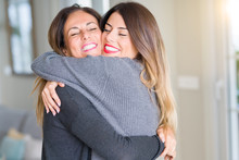 Beautiful Family Of Mother And Daughter Together, Hugging And Kissing At Home