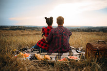 Love Couple Sitting On Plaid, Back View