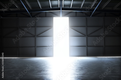 Fototapeta Empty building hangar with the door open with room for text or copy space. 3d rendering interior obraz