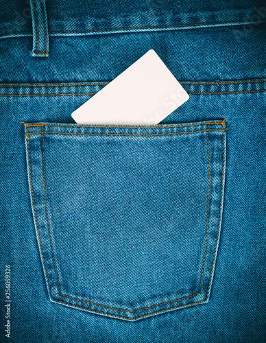 Fotografía  empty paper card is in the back pocket of blue jeans