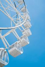 View Of Ferris Wheel Against Blue Sky