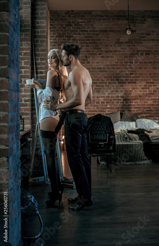 Printed kitchen splashbacks Artist KB Handsome, muscular man seducing his sensual lover