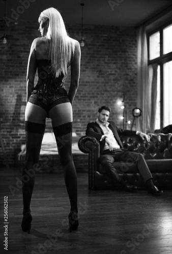 Fototapeta Handsome businessman looking at the sensual woman obraz