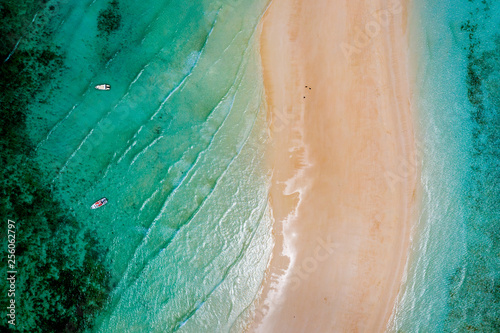 Fototapeten Afrika Sea and beach aerial view, Top view,amazing nature background. Beautiful strip of white sand surrounded by crystal clear water with boats