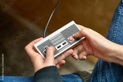 Playing an old gaming console Canvas Print