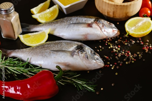 Fotografie, Obraz  Fish seafood dorado, raw food on black background,  background.
