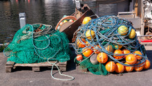 Fishing Nets, Colorful Buoys On The Quay Of The Norwegian Marina.