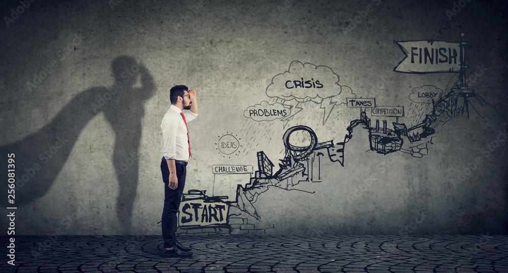 Fototapeta Businessman imagining to be a super hero looking aspired making career plans