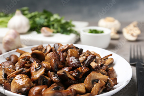 Plate of fried mushrooms on table, closeup Canvas Print