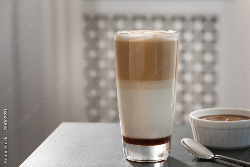 Fototapety, obrazy: Glass of tasty caramel macchiato and syrup on table. Space for text