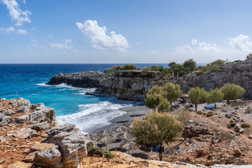 View over bay of Marmara Beach with parasolas on the beach and turquoise waters in front of a tavern near the Aradena gorge on Crete island, Greece