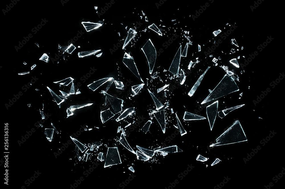 Fototapeta broken glass with sharp pieces over black