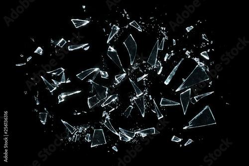 broken glass with sharp pieces over black - fototapety na wymiar