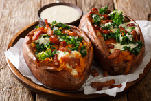 Serving Of Baked Sweet Potato Filled With Fresh Kale, Bacon And Cheese Sauce Close-up On A Plate. Horizontal