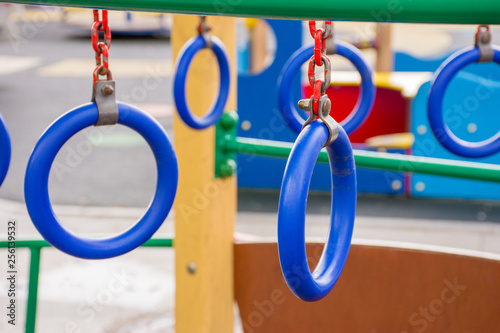 Fotografia  Blue rings on a children's playground in the street
