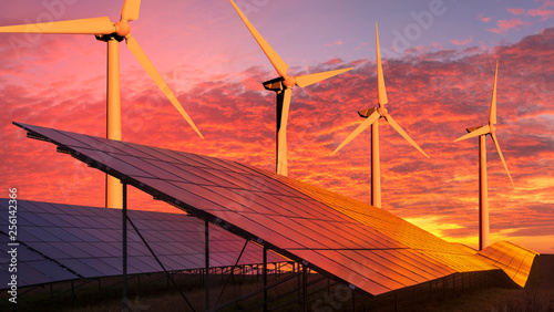 Obraz clean energy concept, photovoltaic panels and wind turbines in the light of the rising sun - fototapety do salonu
