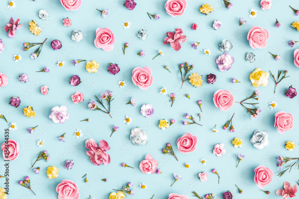 Flowers composition. Pattern made of colorful flowers on pastel blue background. Spring, easter, summer concept. Flat lay, top view