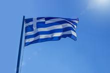 Greek Flag Waving Before Sun O...