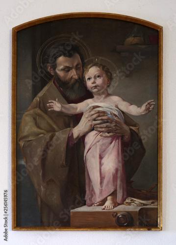 Tableau sur Toile Saint Joseph holding child Jesus, altarpiece in chapel in Hinterbrand, Germany