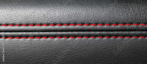 Fototapeta Modern sport car black leather interior. Part of leather car seat details with red stitching. Car detailing. obraz