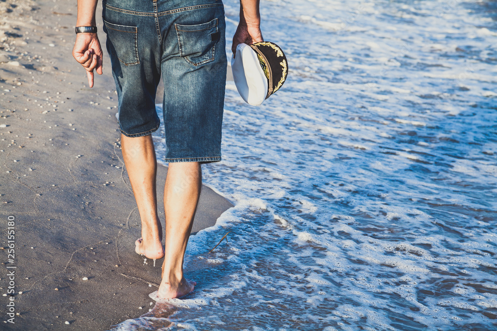 Fototapety, obrazy: Man walks on the sea beach