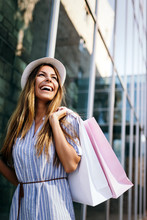 Beautiful Woman With Shopping Bags In The Ctiy. Sale, Shopping, Tourism And Happy People Concept