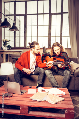 Photo Two musicians playing in the band composing new song at home