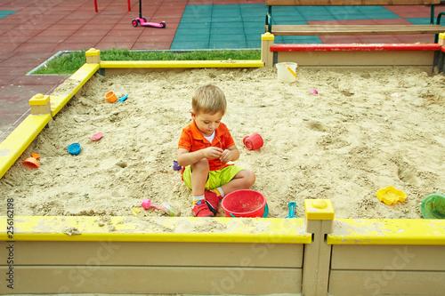 Photo  little boy on playground. playing child in sandbox
