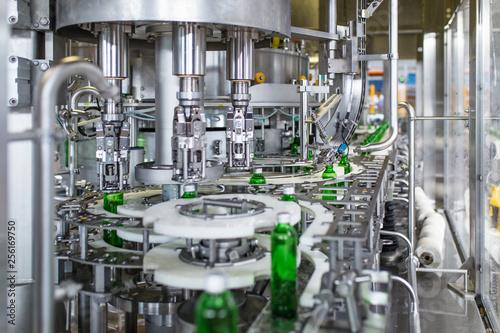 Fotomural Bottling plant - Water bottling line for processing and bottling pure spring water into green glass bottles
