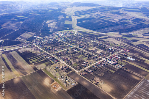 Fotografiet  Aerial view of a square shaped village settlement